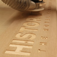 CNC Machine making Wooden Sign